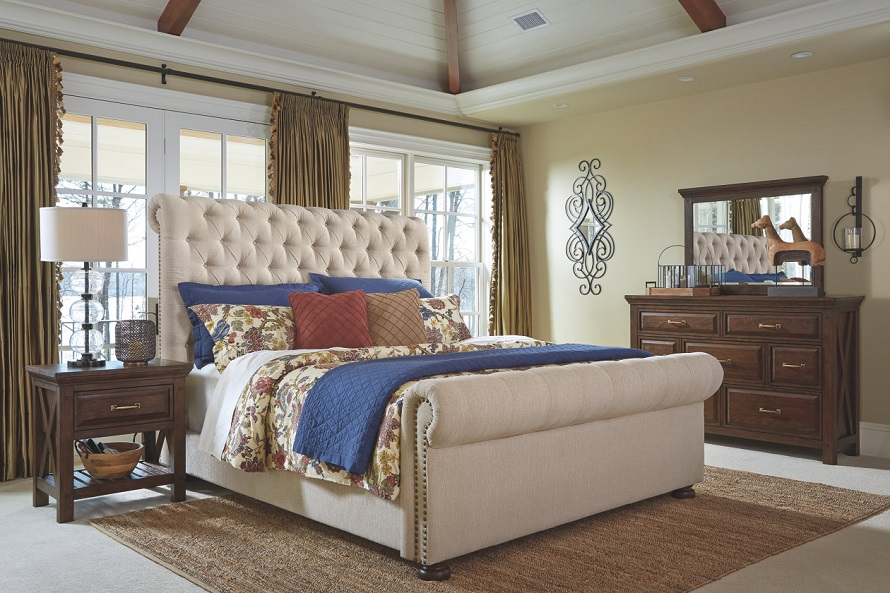 Neutral colored queen sleigh bed