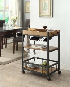 Kitchen cart or bar cart with kitchen utensils stored on it.