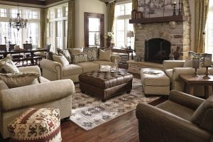 Several neutral and rustic furniture peices in a living room with lots of wood and country elements.