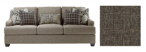 Light gray grainy sofa with dark colored pillows with a paisley design.