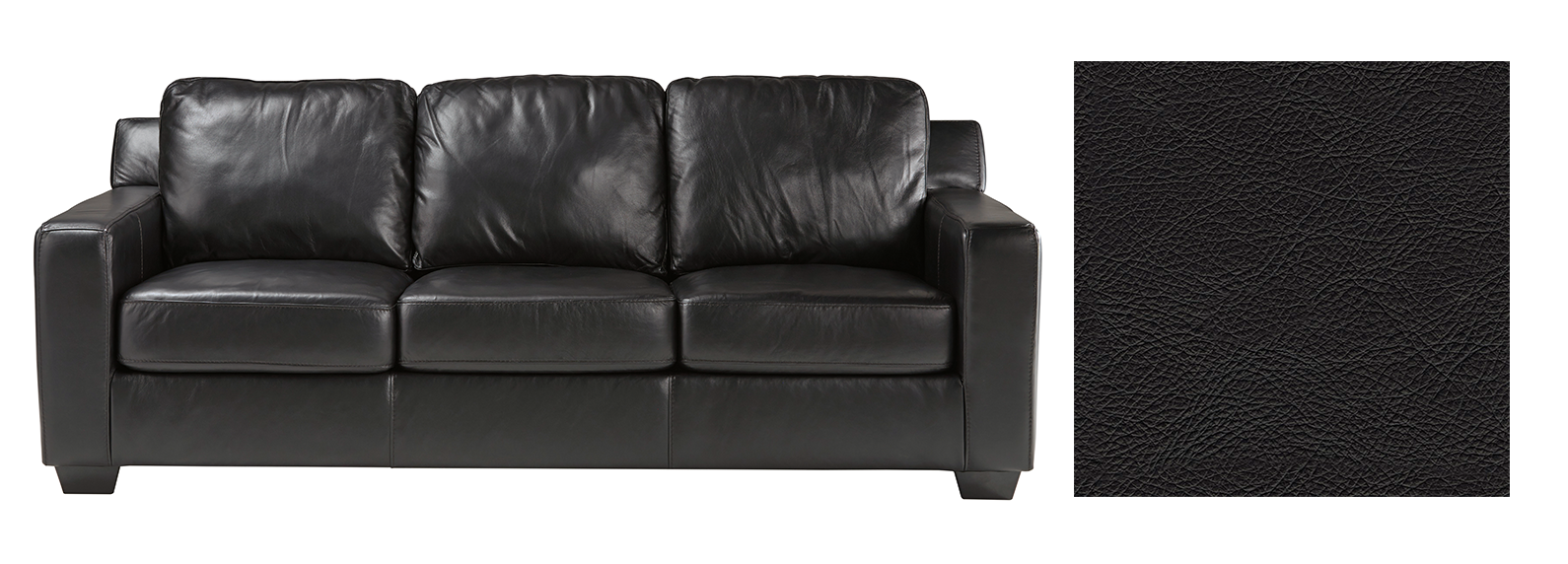 Black leather sofa with a fabric splotch next to it.