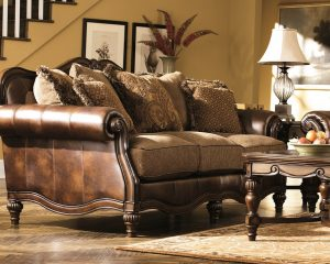 Rich Classic Antique Brown Couch Wrapped in Leather Like Roll Arms and Soft Chenille Seating