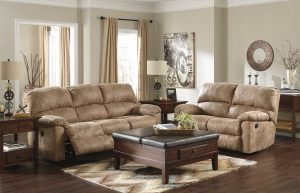 Deep Tufted Cushioning on the Birch Brown Loveseat and Power Reclining Sofa Set Accented with the Ottoman Coffee Table
