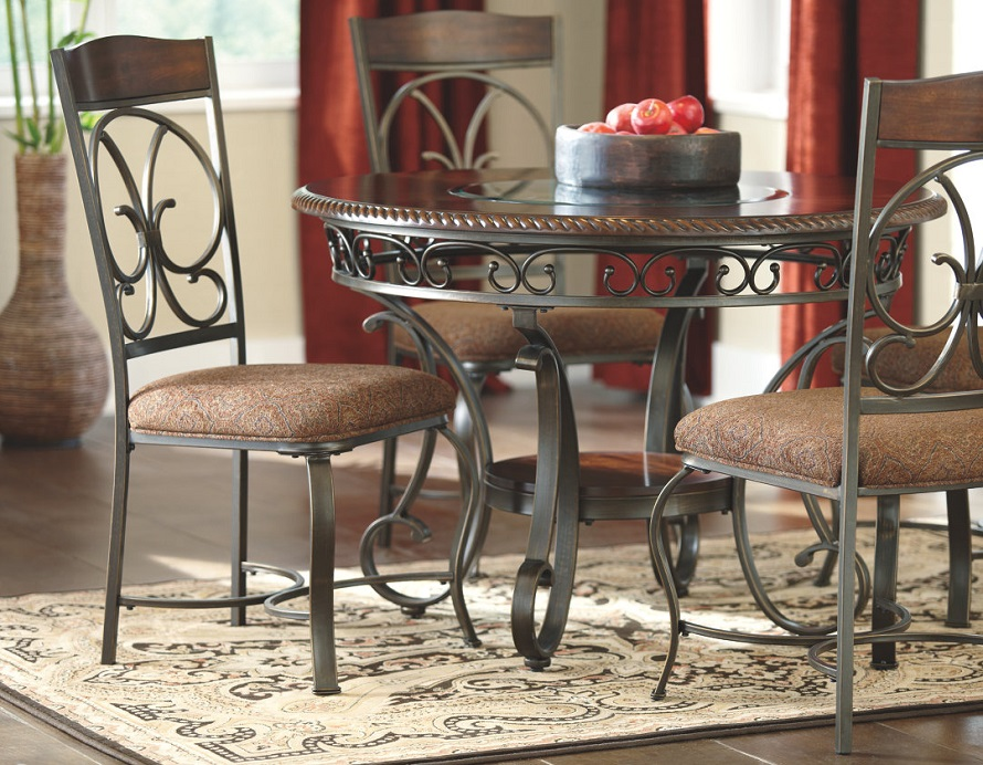 Brown wooden table with a glass top and metal designed chairs