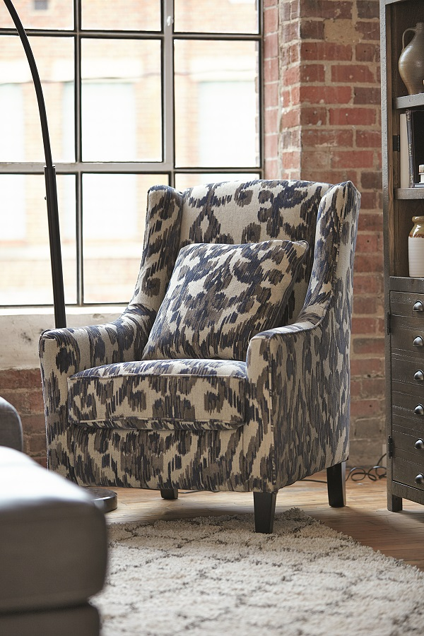 sloped arm accent chair with ikat design in shades of gray