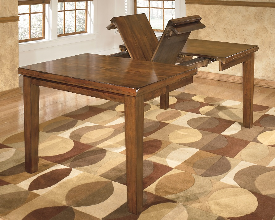 functional view of Strumfeld dining table butterfly leaf folding up
