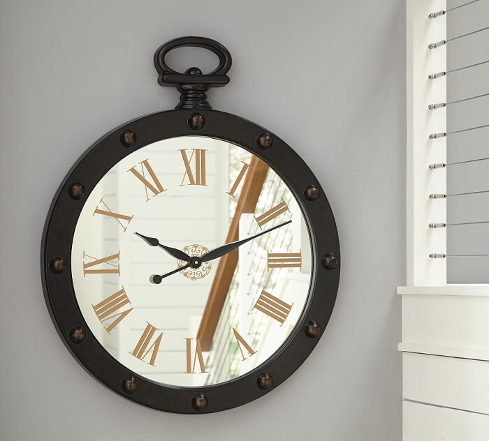 Brown Finished Wall Clock with Rivet Accent. Mirror Face with Gold Finished Roman Numerals
