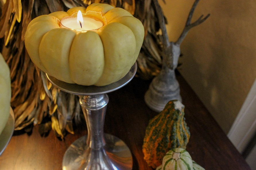 Decorative fall candle made from a mini pumpkin