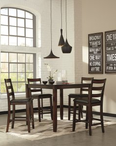 Dining room contemporary table in brown finish in a room with light walls and black accents.