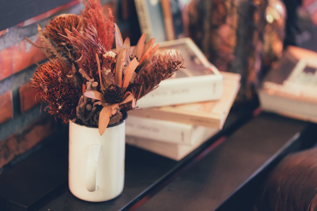 dried flower and plant pot on wood table home decoration modern interior vintage house style.