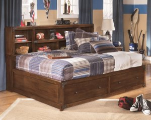 bookcase headboard and under bed drawers provides storage on this twin bed