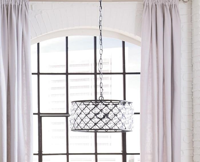 gem-like spheres in open air slots inside a metal chandelier