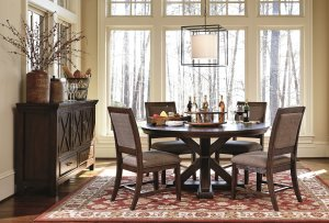 round kitchen table and chairs in a warm brown finish