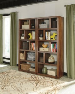 Modern mid-century bookcases with wood finishes standing up next to each other.