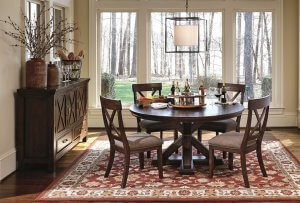 warm dining room table set with three cabinet buffet