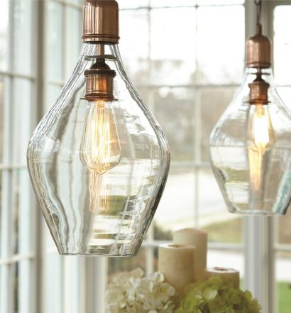exposed copper fittings and clear glass pendants have an industrial touch