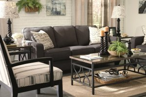 This living room set features a sofa in black
