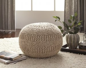 round cable knit wool pouf in natural colored fabric
