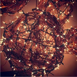 A sphere made from extra christmas lights.