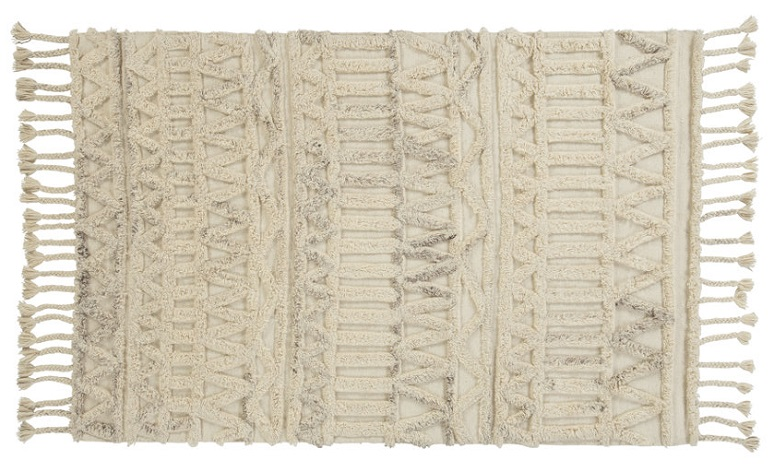 white Moroccan rug with frils and intricate designs.