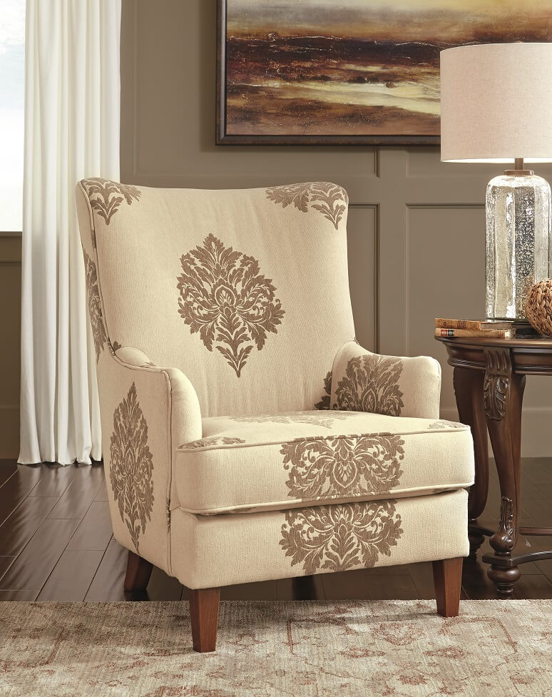 Traditional High Back Accent Chair with cream color and dark brown designs on it.