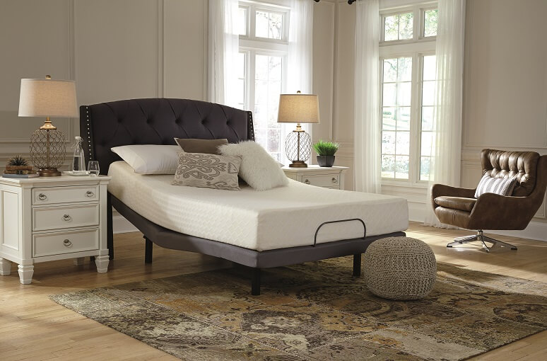 Chime mattress in a bedroom with white nightstands next to it.