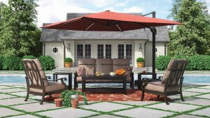 Large red umbrella hovered over an outdoor furniture set.