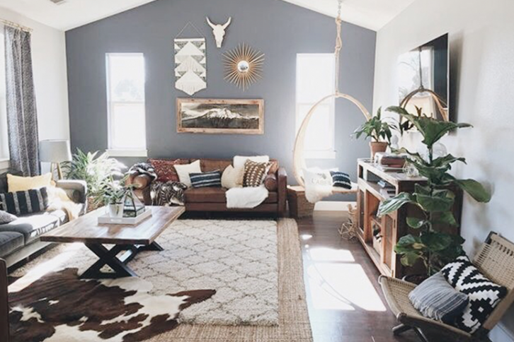 large living room with layered rugs to complete a boho look.