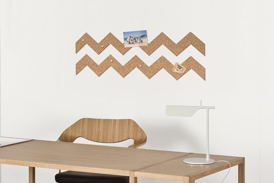 Cardboard sticker above a desk used as trendy wall decor.
