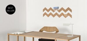 Corkboard sticker above a desk used as wall decor.