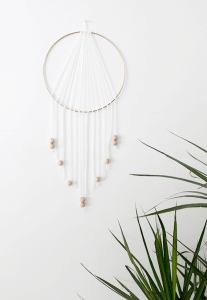 DIY dream catcher handing on a wall.