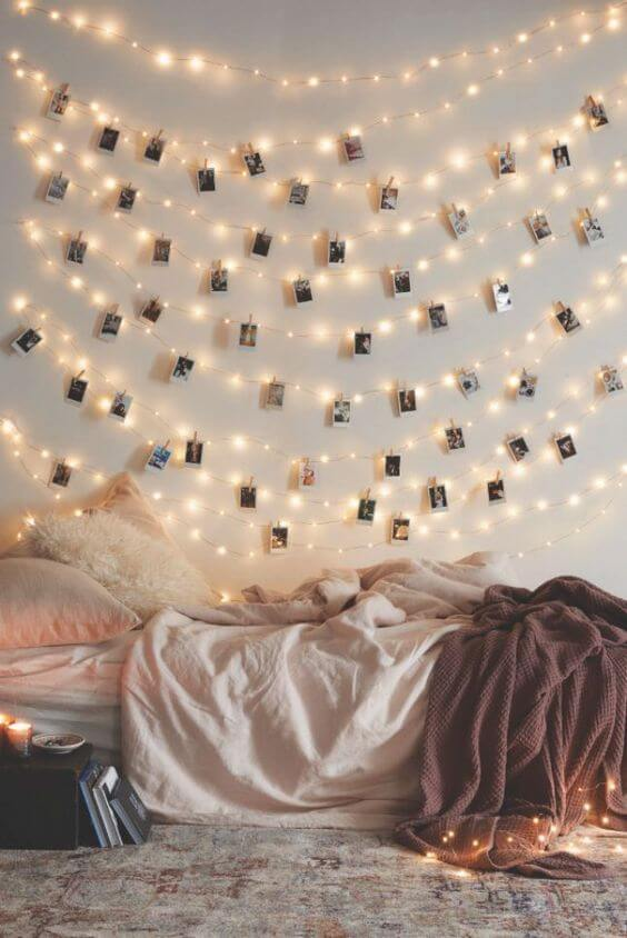 fair lights draped across a well serving as great wall decor for a teenagers bedroom.