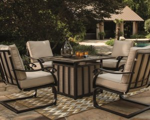 Outdoor conversation set piece with chairs surrounding a table