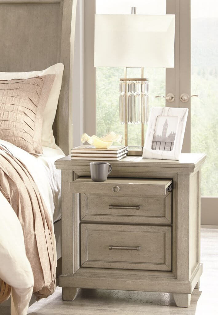 Short gray dresser with accessories.