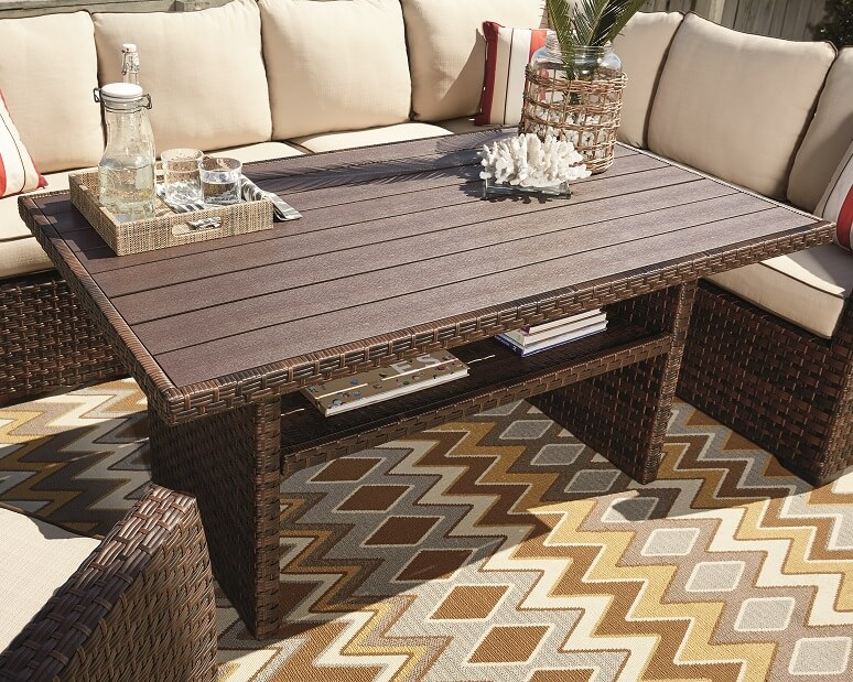 An outdoor multi-use table used as for an outdoor working space.