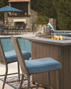 Outdoor bar table with a built in fire pit.