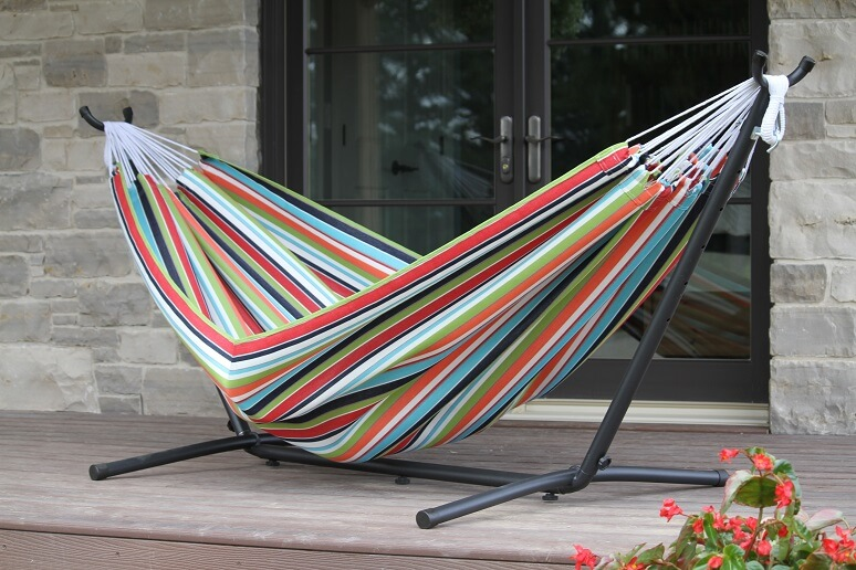 Colorful striped hammock on a porch.