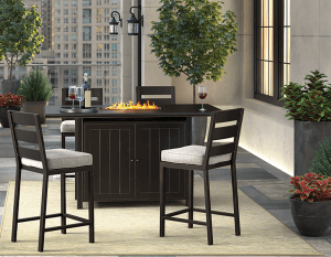 Outdoor bar set with two counter height bar stools.
