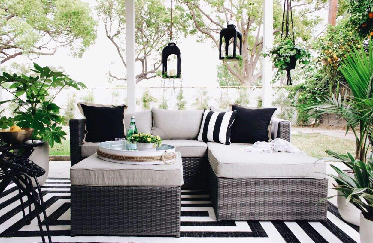 gray patio set with black pillows