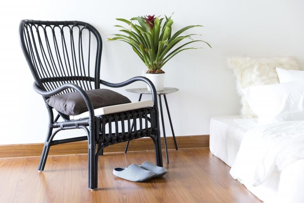 black rattan chair in bedroom