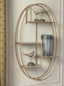 gold wall shelf with accessories