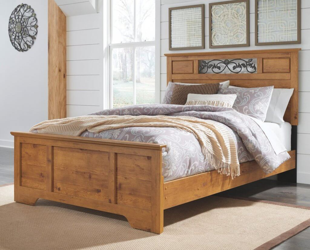 wooden bed in room