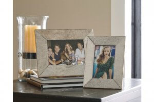 two photo frames on table