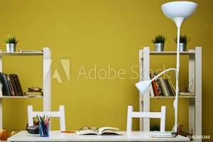 desk in small work space with yellow walls