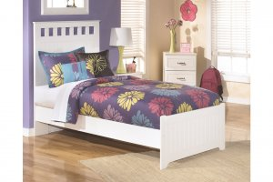 white twin bed with colorful sheets