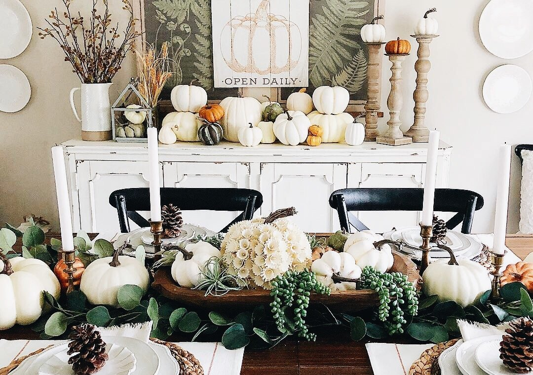dining room table decorated for fall with pumpkins