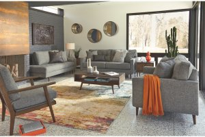 contemporary living room with gray sofas and orange accents