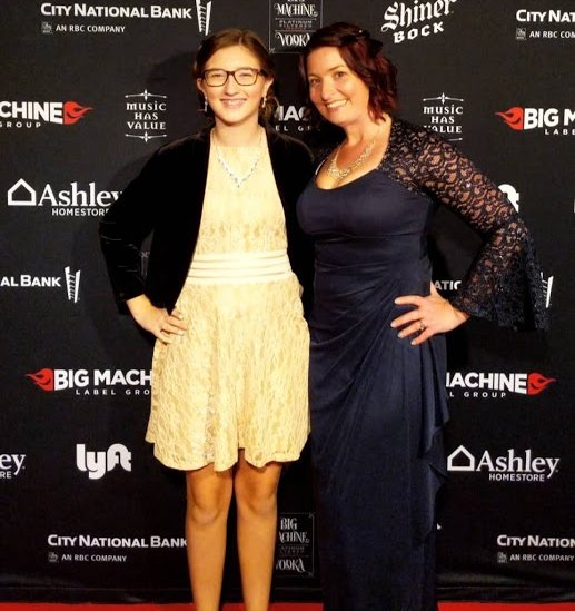 teenager and mother on red carpet