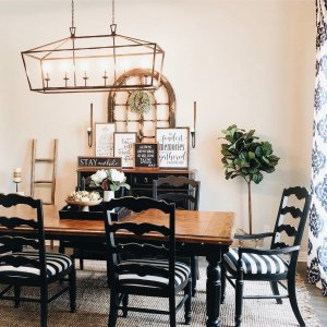 brown dining table with black chairs