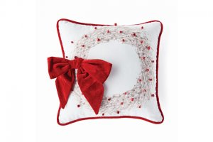 red and white pillow with box on it